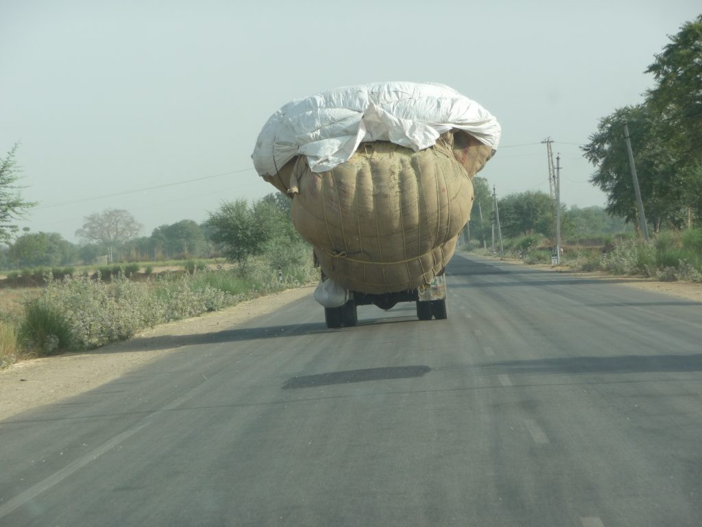 overloaded trucks on the streets of India